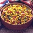 Easy Corn Salsa - Canned sweet corn is mixed with an orange bell pepper, jalapeno pepper, and red onion in this quick salsa recipe that's best if chilled overnight, but also a great quick resolution when you need salsa now!