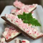 Milk Chocolate Peppermint Bark - This peppermint bark has a delicious milk chocolate layer on the bottom with white chocolate and bits of candy canes on top.