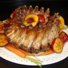 Special Occasion Stuffed Crown Pork Roast - Nothing says festive like a stunning crown roast, carved into ribs and served with a sweet and savory cranberry apple stuffing. Your butcher can tie the roast for you. Serve with a simple pan gravy made with the drippings.