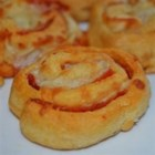 Pizza Pinwheels - You'll want to pop as many of these little pizza wheel treats into your mouth as will fit.  Crescent roll dough provides a mouth-watering crust. Try experimenting with different types of cheese to vary the flavor.