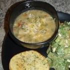White Chili IV - Cubed chicken breast meat is slowly simmered with chile peppers, bell peppers, mushrooms, beans, white wine, herbs and spices in this chili-like soup.