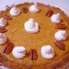 Pumpkin Cheesecake Pie -  Both the crust and the filling are super in this delicious pie. The crust is a tasty crumble of graham cracker, pecan and ginger. This lovely mixture is pressed into a 9-inch pie tin, and filled with a scrumptious pumpkin pie filling boasting cream cheese, brown sugar, cream, eggs, cinnamon, ginger, nutmeg and cloves. The pie is then baked and garnished with whipped cream and pecan halves.