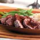 Burgundy Pork Tenderloin - Impress your guests with a pork tenderloin, lightly seasoned and baked, and served with the simple red wine sauce that cooks along with the pork. All you have to do is smile and accept the compliments.