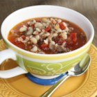 Quick Hoppin' John Soup - This is a modification of my father's hoppin' john recipe. The only difference between his and mine is the use of tomatoes. It's a great recipe for the holidays (New Year's) or any time during winter months. There are many versions of this recipe here, but this one is quick so you can throw it together after a long day at work for the whole family to enjoy!
