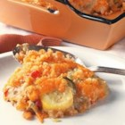Calico Squash Casserole - A rich and creamy squash casserole with garden favorites yellow and zucchini squashes combined with mushroom soup, water chestnuts, carrots and pimentos, baked in a buttery cracker crust.