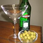 Perfect Gin Martini - Crisp, clean gin martini cocktail.  One is not enough! Chill the gin in the freezer overnight before preparing the drink. This prevents the ice from melting and diluting the drink. Do not allow plastic or metal of any kind to touch the drink.