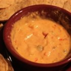 Irene's Christmas Cheese Dip - It is worth the trouble to use the fresh ingredients. The red and green peppers add the colors of Christmas.