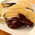 Chocolate Covered Potato Chips - Ridged potato chips are dipped into tempered milk chocolate for an elegant treat that everyone will enjoy. This recipe also works for pretzels, popcorn and any kind of nut.