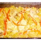 Cheesy Chicken Tetrazzini - In this great one-dish meal, chicken breast pieces sautee with mushrooms, red peppers, onions. They are then bathed in broth, cream, and sherry; tossed with pasta, Parmesan, and parsley; then baked -- with a secret ingredient, Jarlsberg cheese, melted on top!