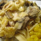 Creamy Swiss Chicken Casserole - Cheesy chicken breasts and a smooth mushroom sauce are served over egg noodles.