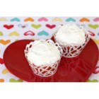 Cherry Amish Friendship Bread Cupcakes with Buttercream Frosting - Pink cherry cupcakes topped with fluffy buttercream frosting make a perfect treat for Valentine's Day, an anniversary, shower, or any romantic occasion.