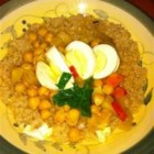 Soup For Couscous - This garbanzo bean, sauteed vegetable and hard boiled egg stew seasoned with turmeric and coriander is a vegetarian delight meant to be served spooned over a mound of cooked couscous.
