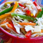 Calico Slaw - Crunchy cabbage slaw with apples, peppers, and carrots.