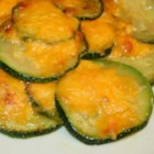 Lynda's Zucchini - Quick, easy and very good.  I always make it as an appetizer for  barbecues at home. Melted Cheddar cheese provides a wonderful, simple topping for the sauteed zucchini slices.