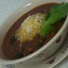 Easy Turkey Chili  - Ground turkey is simmered in a hearty combination of black, kidney, and refried beans.
