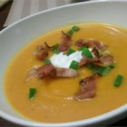 Roasted Butternut Squash Soup with Apples and Bacon - This curried squash soup has a very creamy consistency but is completely dairy-free except for the optional garnish of sour cream. Roasting the squash adds an extra depth of flavor.