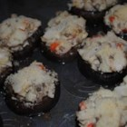 Crab Stuffed Mushrooms II - The Dijon mustard adds a different twist to this delicious appetizer! Water chestnuts are optional, but add a nice texture to the smooth cream cheese and crab filling.
