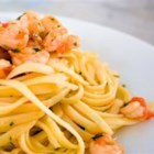 Brandied Shrimp with Pasta - Shrimp are cooked with brandy, white wine, garlic and fresh basil in a butter-olive oil sauce.