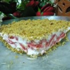 Frosty Strawberry Dessert - Sweetened strawberries and egg whites are frozen over crunchy walnut crumbs in this easy and rewarding dessert!