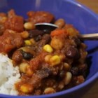 Rae's Vegetarian Chili - This is a low-fat, high-protein recipe. For vegan, simply leave out the cheese. The variety of beans adds a nice touch of color, and it can be made as mild or spicy as you like it. Remember to recycle all those cans we used.
