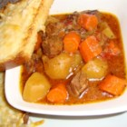 Swiss Steak Stew - Serving-sized pieces of boneless round steak are dredged with  flour and browned, then layered in a slow cooker with potatoes, onions, canned tomatoes, and seasonings. Corn is added for the last 25 minutes of cooking.