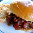 Sloppied Flank Steak Sandwiches - A tangy, tomato-based sloppy joe sauce with brown sugar and apple cider vinegar makes a good sauce for chopped steak, too. Make it in a slow cooker, and pile it on toasted buns.