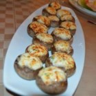 Crab Stuffed Mushrooms - This tasty appetizer seasoned with thyme, oregano, and savory.  Choose good sized mushrooms, about 2 inches across.  When cleaning mushrooms, don't run them under water.  They are like little sponges, and will absorb it; just wipe them clean with a damp towel.  The filling can be made with fresh, canned, or imitation crabmeat.  If using canned, be sure to rinse it first.