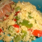 Christmas Couscous - This is my own creation. It is both tasty and healthy. It looks great on Christmas plates. The couscous is off-white, the peppers are green and red; the colors of Christmas. Taste and you'll know why it is my favorite recipe.