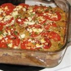 Squash with Tomato and Feta Cheese - This is a savory alternative to sweetened squash side dishes. Acorn or other winter squash is baked with dry stuffing mix, tomatoes, onions, green pepper, and feta cheese.