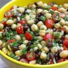 Balela Salad - This quick Middle Eastern-style bean salad, made with garbanzo and black beans, plus lots of sweet grape tomatoes, has a tangy and slightly spicy blender dressing.