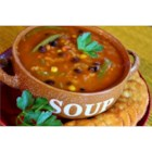 Sola's New Year's Soup - Start the New Year off with a good-luck bowl of this hearty soup made with black beans, black-eyed peas, bell pepper strips, corn, prepared salsa, chili powder, and rice.
