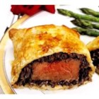 Beef Wellington - Filet of beef tenderloin is assembled with liver pate, mushrooms and onions, then wrapped in packaged puff pastry. It bakes quickly and makes a beautiful dinner party entree.