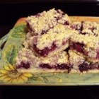 Berry Crumb Bars - Economical and easy to make bars. Kids love them.  You can use any variety of berry that you like; we used raspberries in this recipe.