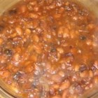 Maple and Ginger Baked Beans - Baked beans made from scratch in the slow cooker. It takes a lot of time to cook, but not a lot of work. Use Yellow Eye beans if they are available in your area, and grade A amber maple syrup if you can.