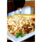 Creamy Linguine with Clam Sauce - White clam sauce is even easier when you use store-bought Alfredo sauce. Extra garlic and onion gives it a great homemade taste.