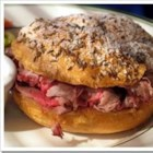 Beef on Weck - An easy roast beef sandwich with local origins in Buffalo, New York.  Kimmelweck rolls are hard kaiser-type rolls covered in coarse ground salt and caraway seeds. This recipe transforms regular rolls into the traditional weck rolls.