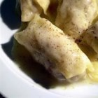 Cabbage Rolls I - Cabbage leaves stuffed with ground beef, rice, tomato and onion, spiced with cinnamon and baked.