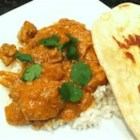 Slow Cooker Butter Chicken - Chicken thigh meat cooks with tandoori masala and garam masala in a sauce of coconut milk and tomato in this tasty Indian classic.