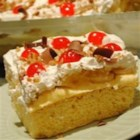 Banana Split Cake III - Your favorite banana split ingredients on a cake base. A summer treat. decorate with cherries and your favorite chopped nuts.