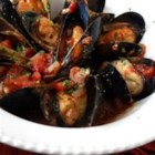 Love Mussels - You will love these mussels cooked in a tomato sauce accented with garlic, shallots and capers.