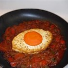 Shakshooka - Saffron, paprika, and parsley flavor this Israeli dish of tomatoes, bell pepper, onion, and fried eggs. Serve hot with tahini sauce and pita bread.