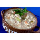 Easy White Chili II - This slow cooker recipe uses chicken bouillon cubes and navy beans with chicken to make a hearty white chili.