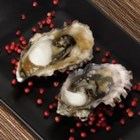 Grilled Oyster Shooters - Oysters are cooked on the grill in the shell, then seasoned with lemon juice, hot sauce and Worcestershire sauce. A cooked, nonalcoholic version of a well-known favorite, great as an appetizer.
