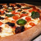 Ricardo's Pizza Crust - This herb laced pizza crust is mixed in the bread machine but baked in the oven. Add your favorite toppings to make a delicious main dish.