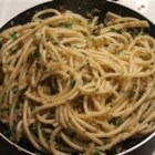 Sicilian Spaghetti - Anchovies sauteed with garlic and oil makes a pungently tasty sauce for hot spaghetti. Add some breadcrumbs and parsley to the anchovy mix and toss with the noodles to serve.