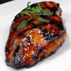 Asian Grilled Chicken - The flavorful marinade for these grilled chicken thighs is a little sweet, a little salty, and a little tangy, with a hint of spice from Asian chili sauce, curry, and garlic.