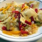 Cheese Ravioli with Three Pepper Topping - Cheese ravioli topped with green, red and yellow peppers. A nice change from tomato sauces.