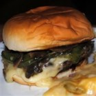 Eddie's Special Burgers - Hamburgers made with sauteed onions, green peppers and mushrooms, topped with mozzarella cheese and Italian-style dressing.