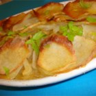 Candie's Easy Potato and Onion Dish - Sliced potatoes are baked with sweet onions, butter and parsley for a surprisingly easy and tasty dish.