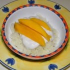 Sweet Sticky Rice with Mangoes - This delicious traditional Thai dessert combines coconut-scented sticky rice with a sweet coconut sauce and a topping of fresh, ripe mangoes.